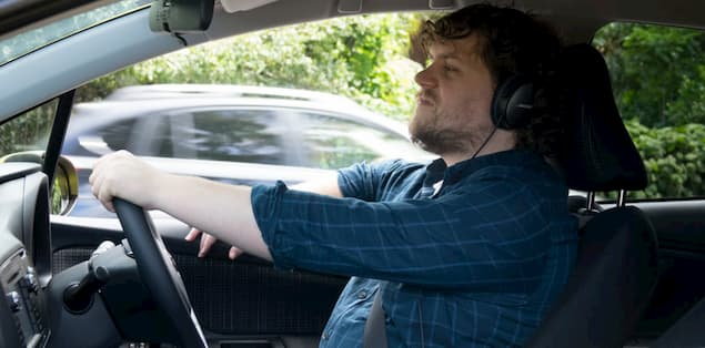 Can I wear headphones will driving