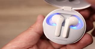 A pair of LG Tone earbuds